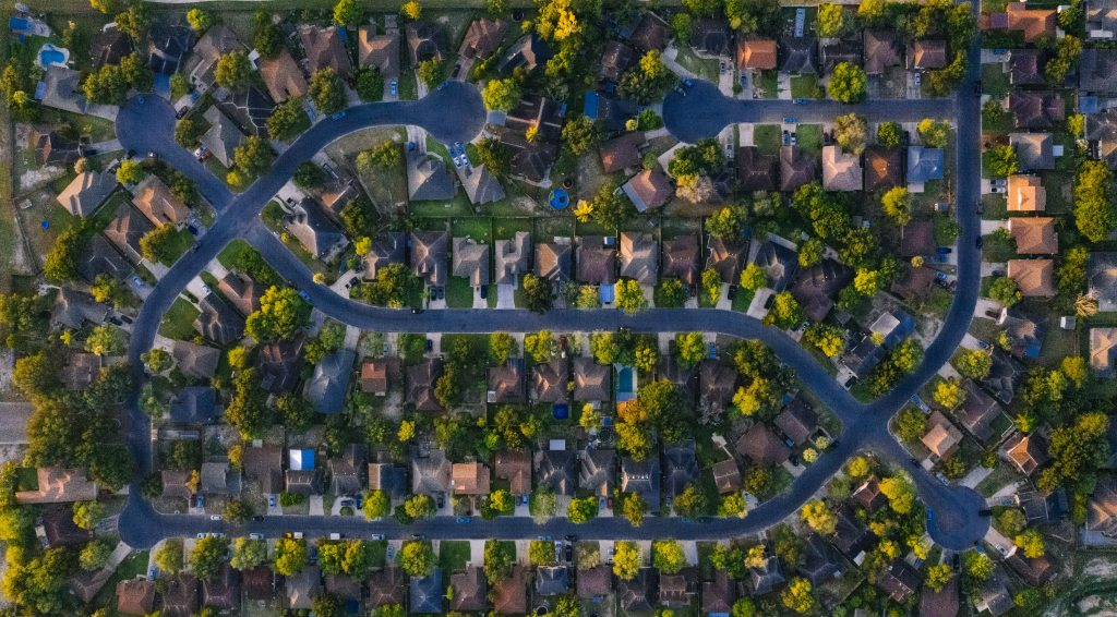 Birdseye view of a residentional neighborhood to illustrate real estate market