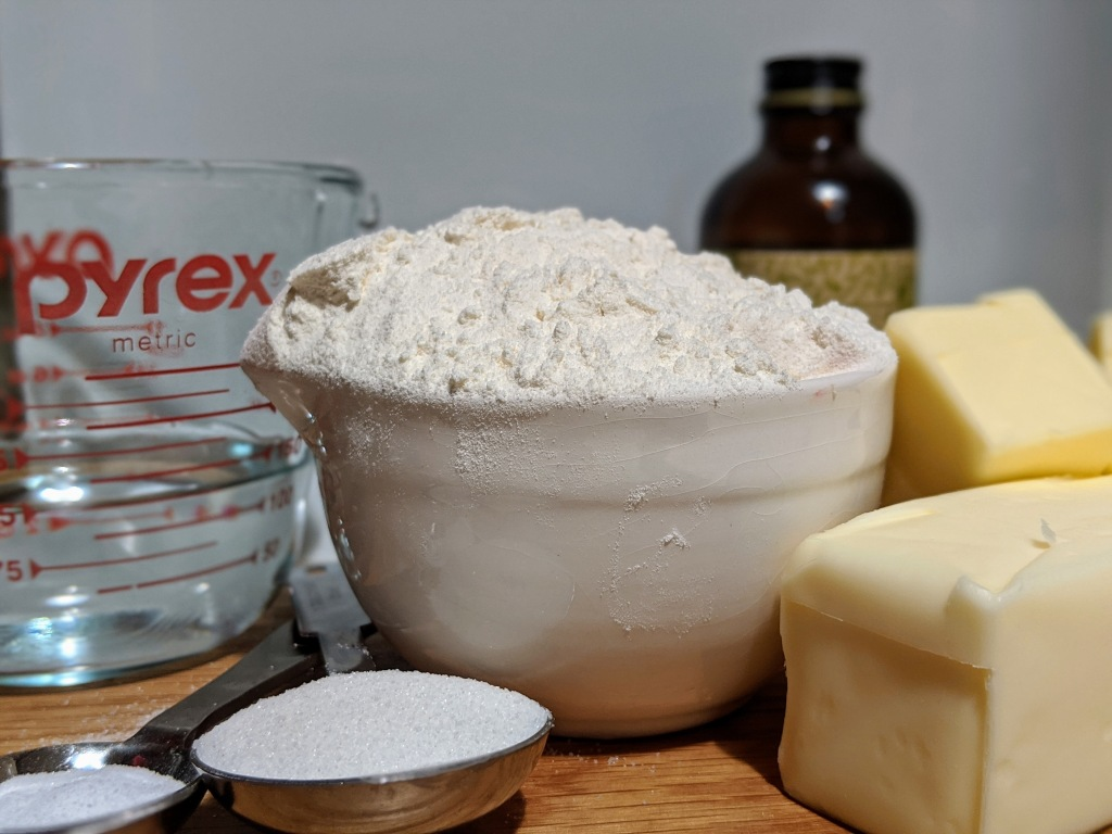 All of the pie crust ingredients together including flour, sugar, anf butter